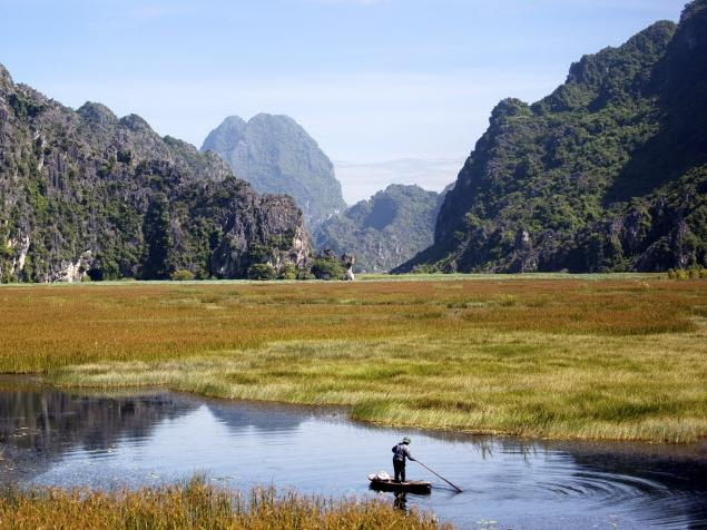 2. NINH BINH, VIETNAM The village of Ninh Binh on the Red River Delta in northern Vietnam is one of the best places to experience the authentic rural side of the country. It also boasts incredible scenery and is dubbed 'the inland Halong Bay' thanks to its rice paddies and wetlands that are surrounded by sheer limestone cliffs.