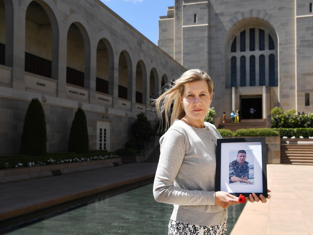 Julie Anne Finney poses for photographs next to the Pool of Reflection in the commemorative courtyard at the Australian War Memorial in Canberra Tracey Nearmy/Advertiser