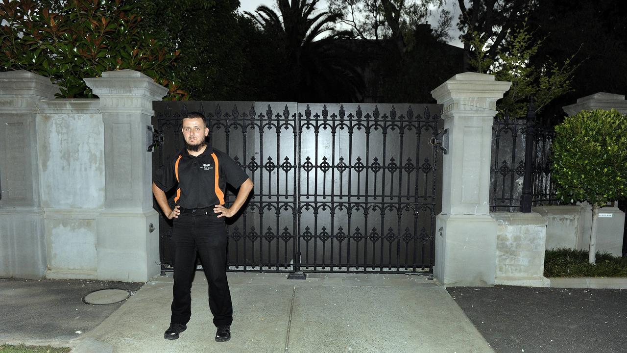A security guard out the front of Shane Warne's home in Brighton during Liz Hurley's visit.