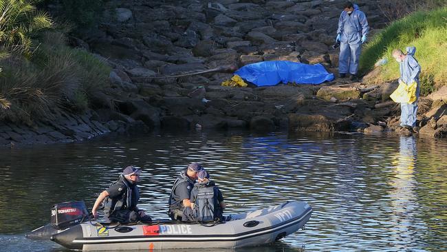 Police continue the search around the area where body parts were found.