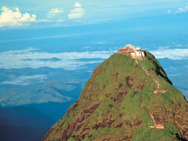 """ADAM'S PEAK, SRI LANKA: A site revered by Muslims, Buddhists, Christians AND Hindus? Yes, it exists. At the top of Adam's Peak in central southwest Sri Lanka (which is the country's holiest mountain and fifth highest peak) is a depression in the rock known as the """"sacred footprint"""". Buddhists claim that it's the footprint of Buddha, Hindus say it's the footprint of Shiva, known as the destroyer god, while Christians and Muslims believe it's the first place Adam set his foot on earth after he was expelled from heaven. Regardless of your beliefs, it's a special place and as such has been an object of pilgrimage for 1000 years. A 7km path takes climbers 2243m up to the summit. The route up is handily peppered with tea shops offering thirst and hunger relief.  srilanka.travel"""