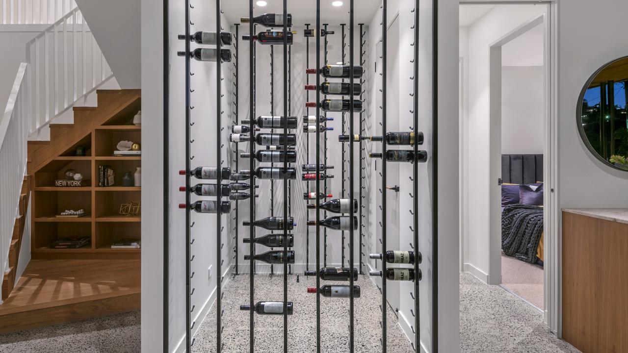 The home has a unique, glass wine cellar.