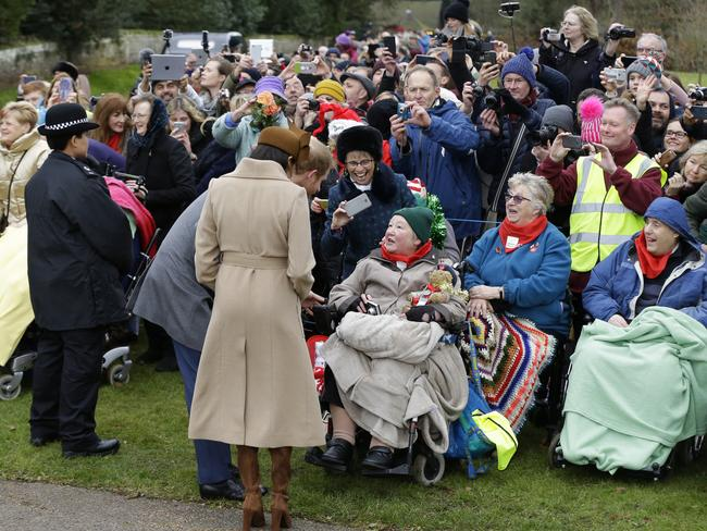 Meghan Markle and Prince Harry were a big hit with the crowds who lined up to see them. Picture: AP/Alastair Grant