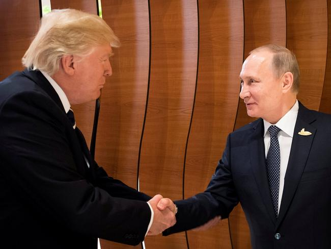 US President Donald Trump and Russia's President Vladimir Putin shake hands during the G20 Summit in Hamburg, Germany. Picture: Reuters