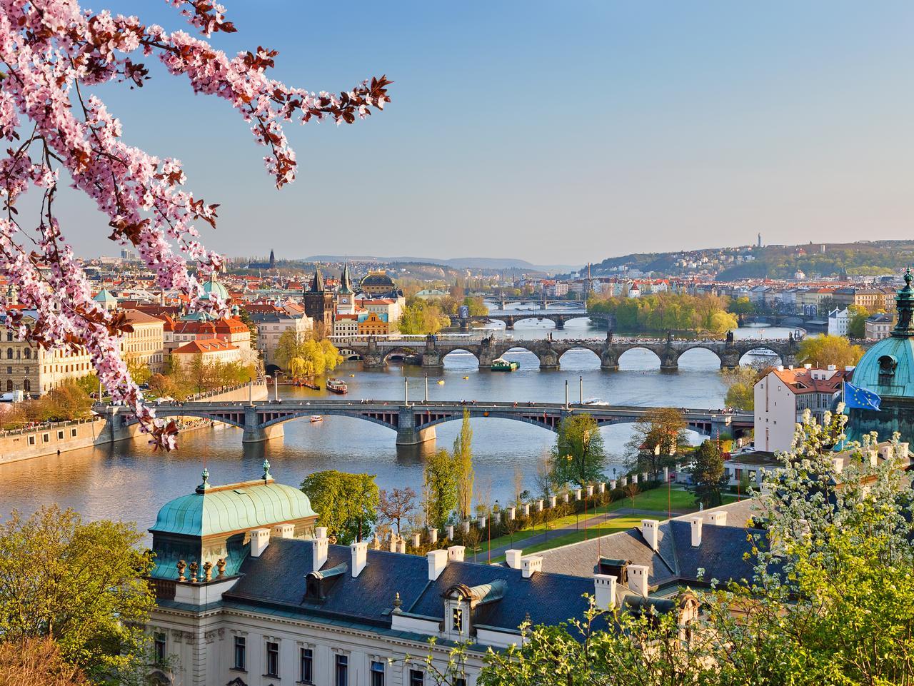 View on Vltava river and Prague at sunset
