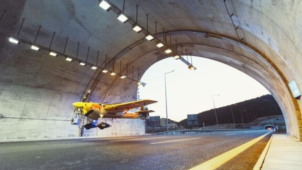 Dario Costa sets world record by flying a plane through a road tunnel.