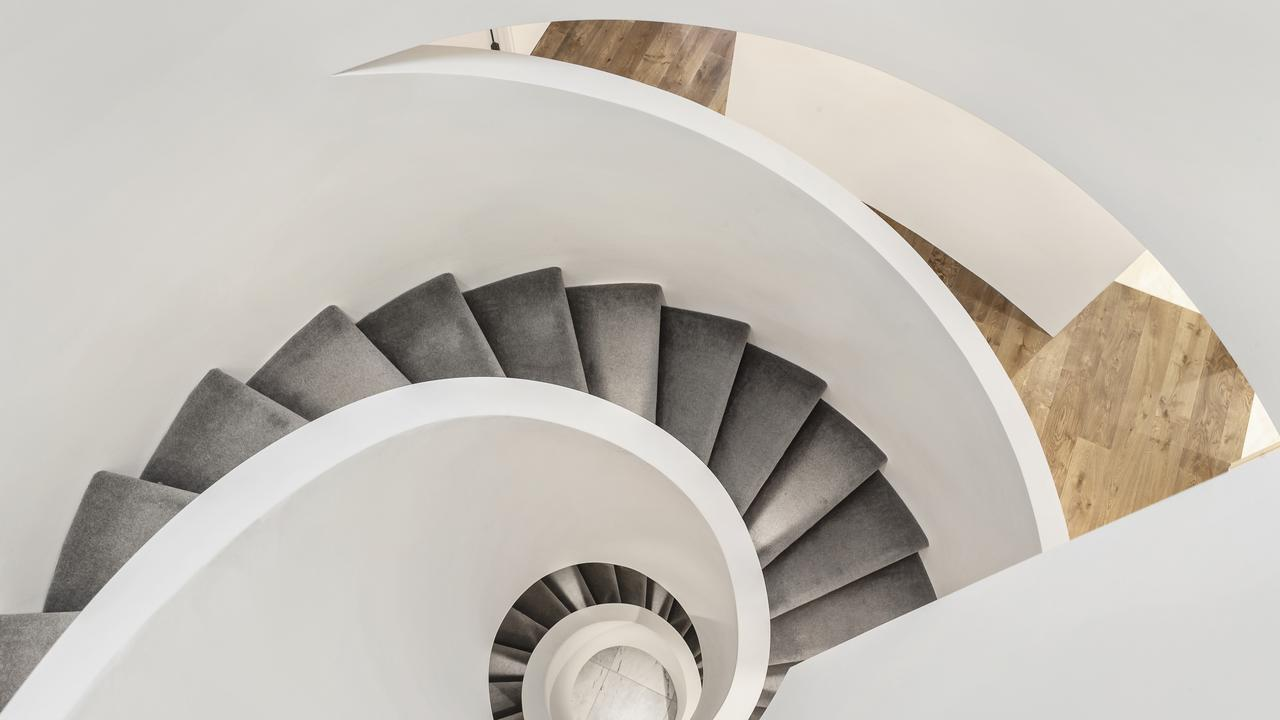 The architect's signature stairwell mixes form and function.