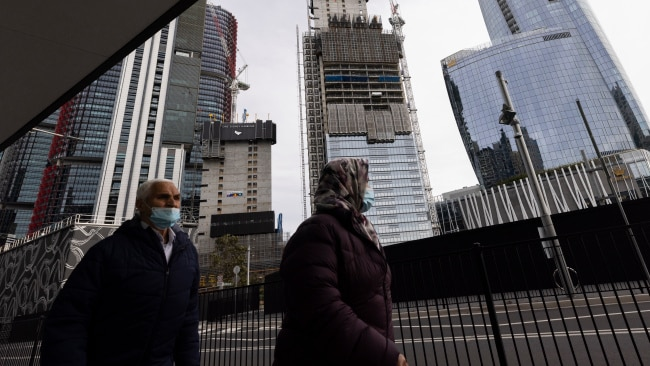 Two people in face masks are seen walking near Barangaroo in Sydney's CBD during lockdown on Tuesday. Photo: Brook Mitchell/Getty Images