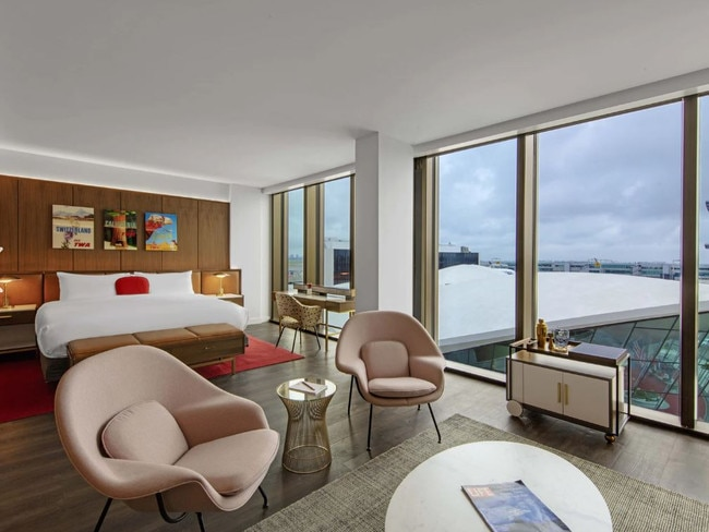 Connected to the terminal through the original red-carpeted flight tubes, the guestrooms are ultra-quiet through a specially-engineered 4.5-inch-thick curtain wall. Sixties-inspired elements in the rooms include Saarinen-designed Knoll furnishings, a martini bar, and a vintage rotary phone.