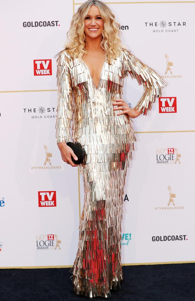 Leila McKinnon let's her hair down and bedazzles herself to smithereens in this golden frock.