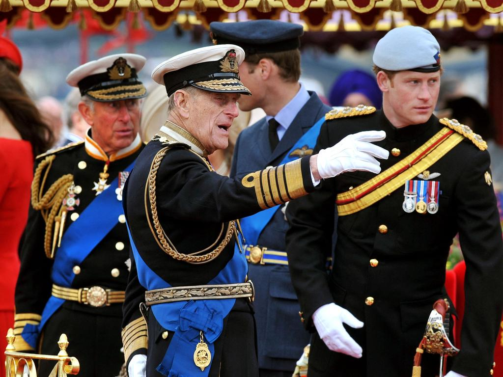 Prince Harry with his grandfather on-board the Spirit of Chartwell during the Thames Diamond Jubilee Pageant on the River Thames in London. Picture: AFP