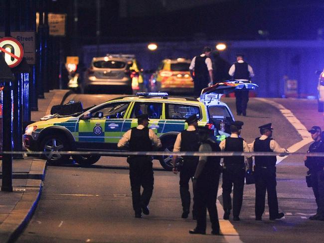 Police officers walk at the scene of an apparent terror attack on London Bridge. Picture: AFP PHOTO / DANIEL SORABJI
