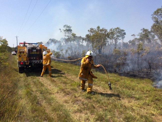 Multiple crews are on the frontlines at Noosa North Shore battling a blaze which broke out this morning, forcing another evacuation. Photo: Patrick Woods/Sunshine Coast Daily