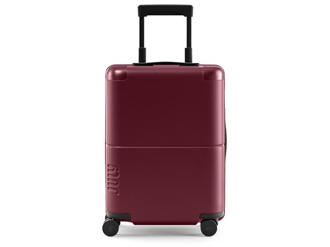 THE JULY CARRY ON — JULY ($295) With a 100-day returns policy and a lifetime guarantee, you can do away with any fears that this stunning carry-on bag won't deliver what it promises. It has a TSA lock, aluminium corner bumpers as well as an ejectable battery with USB-C and USB options. An integrated smell and water-resistant laundry bag also make this one a great weekender.