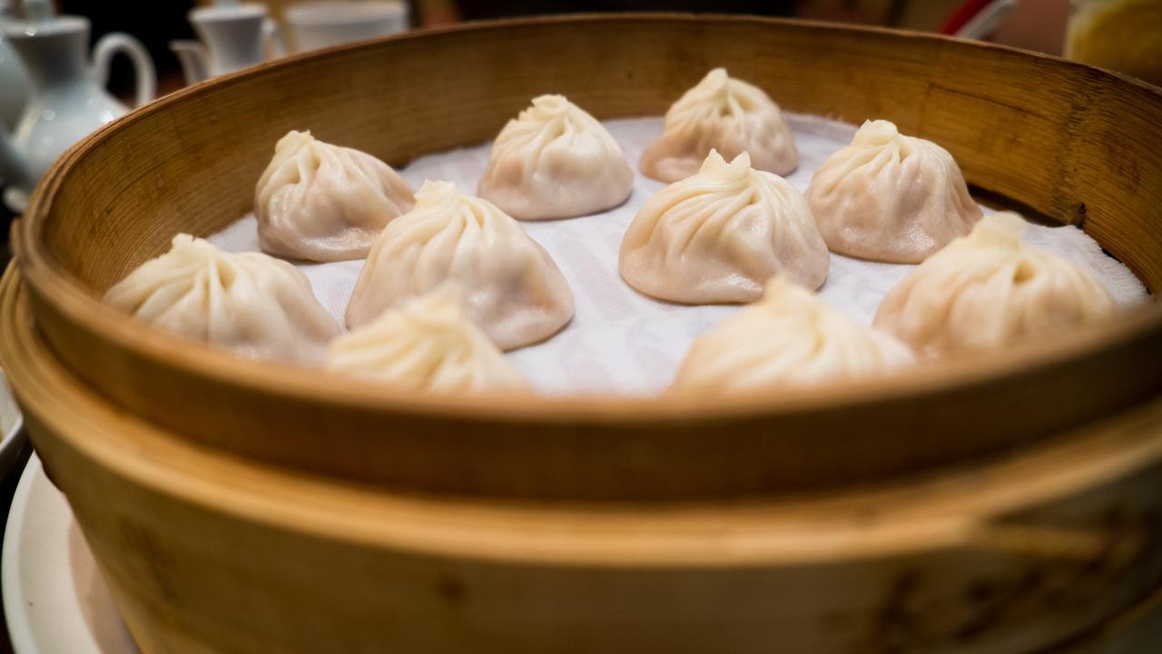 xiao long bao, Chinese soup dumplings, in bamboo steamer.