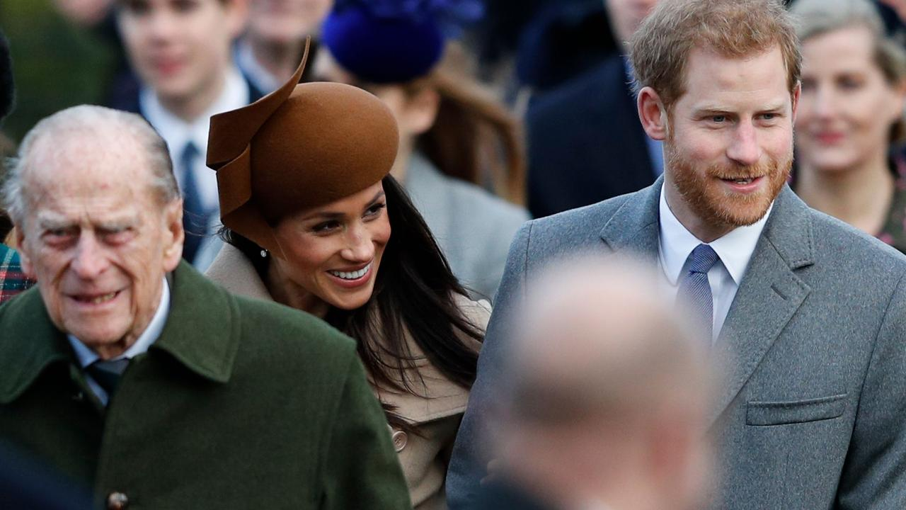 Philip with Meghan and Harry in 2017. Picture: Adrian Dennis/AFP
