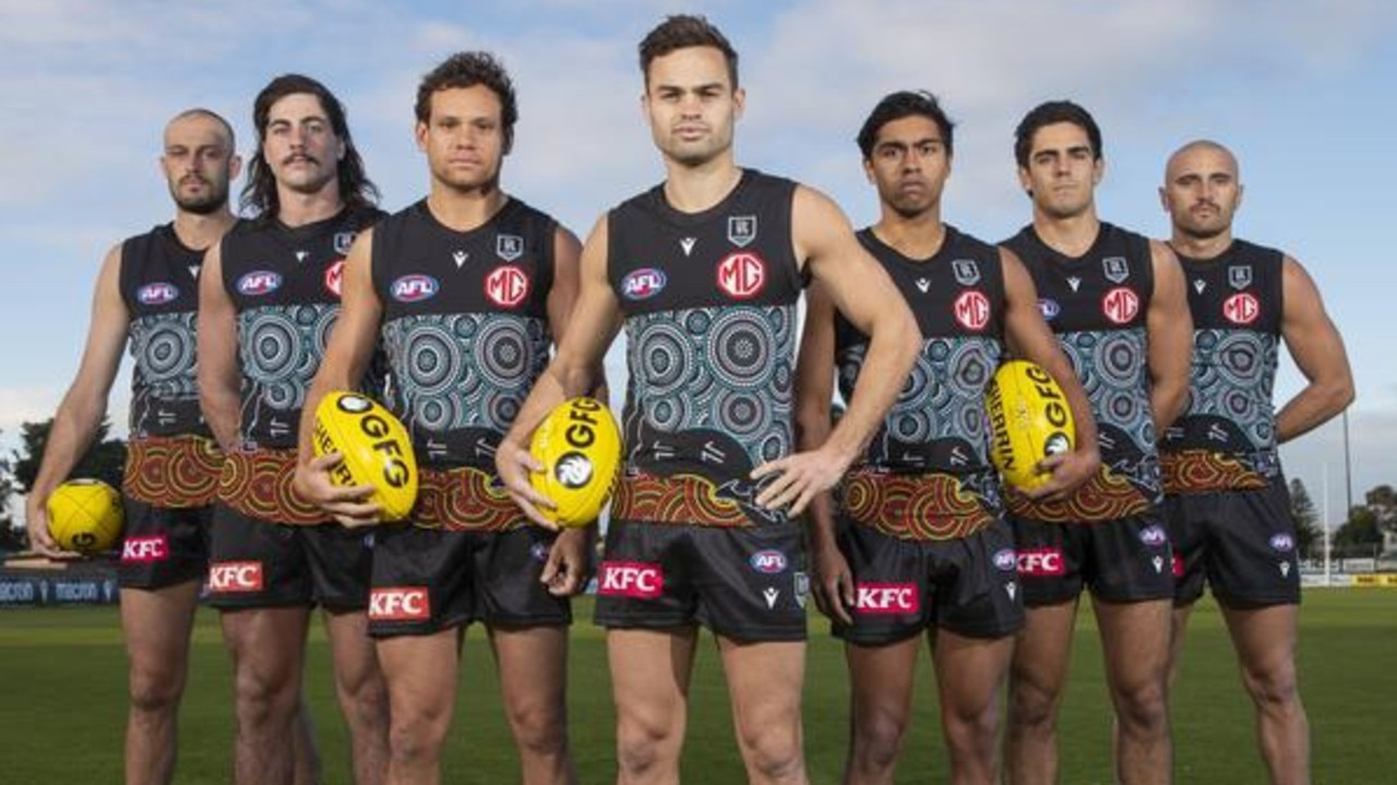 An Indigenous artist has backed Port Adelaide wearing her design for Indigenous Round, after a student won a contest claiming to have created it. Picture: Simon Cross / The Advertiser