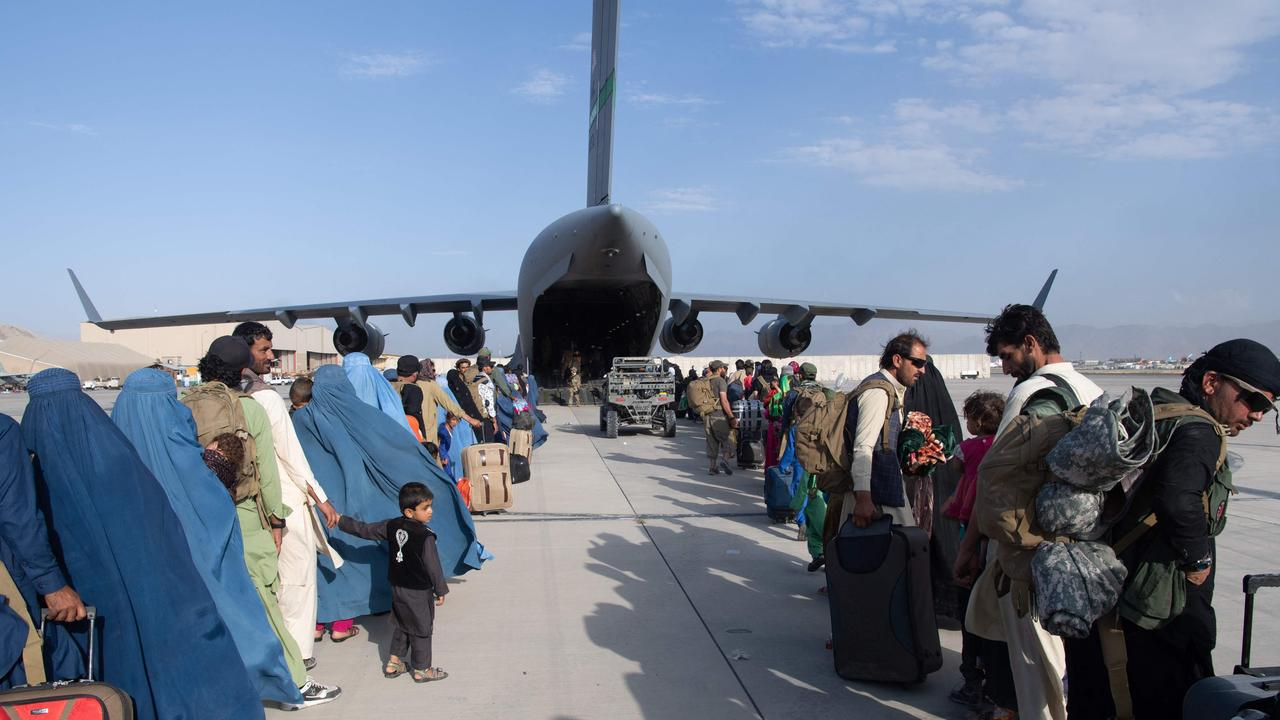 US air force loadmasters and pilots at Hamid Karzai International Airport. Picture: Donald R Allen/US Air Force/AFP