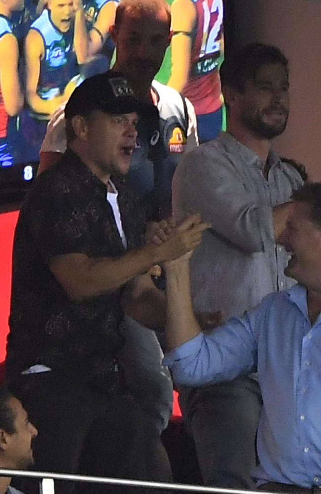 Matt Damon and Chris Hemsworth are seen during an AFL match between the Western Bulldogs and the Sydney Swans at Marvel Stadium in Melbourne in March 2019. Picture: AAP/Julian Smith