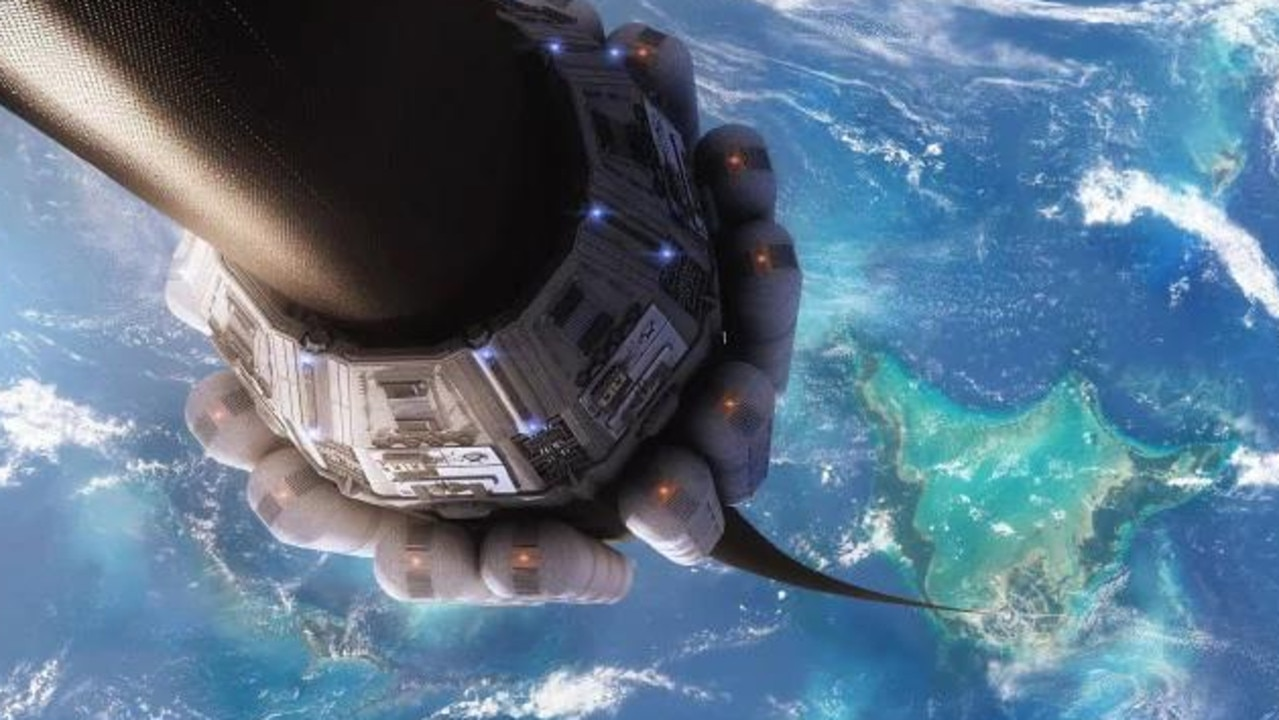 An artists' concept of a space elevator moving along a long tether between its base on a Pacific island and a space station.Source:Supplied