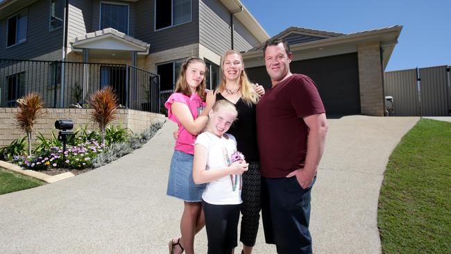 Natasha and Andrew Reid, with their kids Jessica, 12, and Stephanie, 10, have their Holland Park West house up for sale. Picture: AAP Image Steve Pohlner.