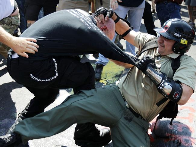 """White nationalists, Neo-Nazis and members of the """"alt-right"""" clash with counter-protesters as they enter Emancipation Park. Picture: Getty"""