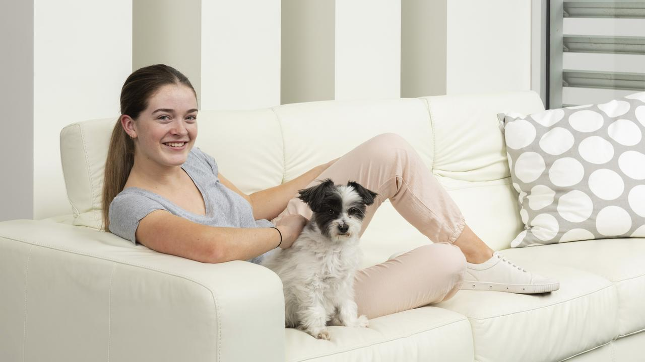 Jade Hameister takes it easy with dog Ava. Pictures: Chris Groenhout