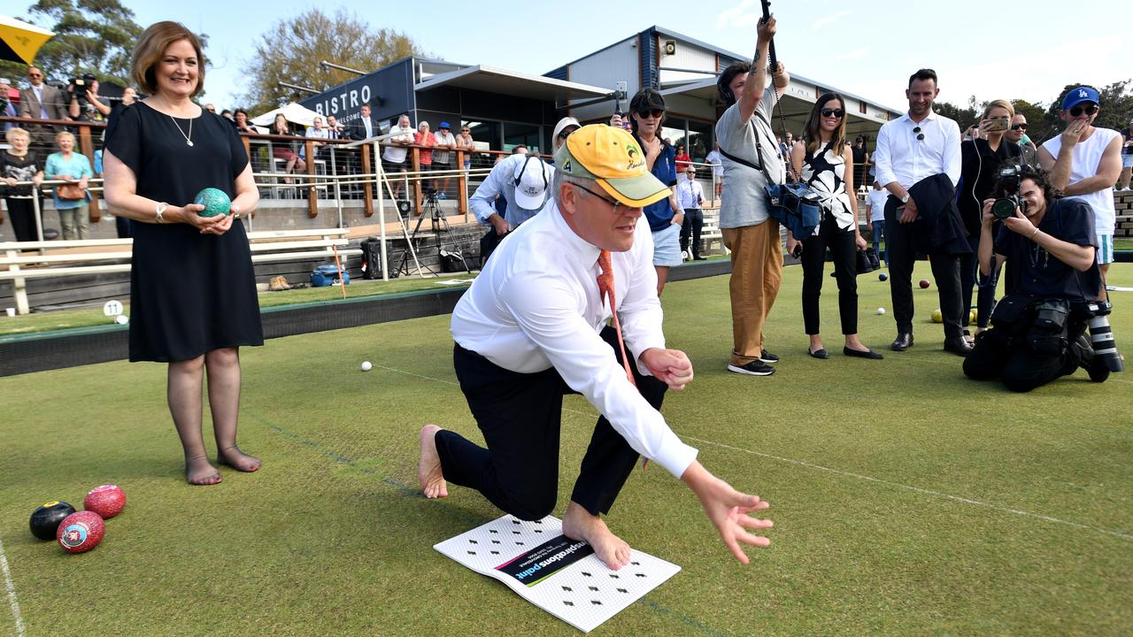 Prime Minister Scott Morrison and Liberal member for Corangamite Sarah Henderson play bowls at the Torquay Bowls Club near Geelong on the campaign trail. Picture: Mick Tsikas/AAP