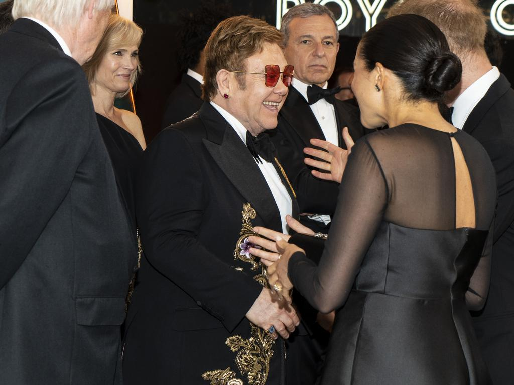 Sir Elton and the Sussexes ... the rock star strongly defended the young couple's right to use a jet. Picture: Getty