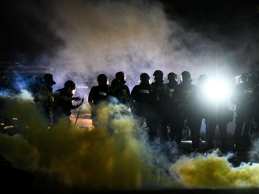 Tear gas fills the air as people confront police outside the Brooklyn Center police headquarters. Picture: Stephen Maturen/Getty Images/AFP