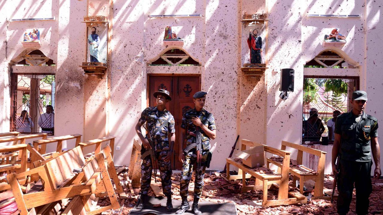 Sri Lankan soldiers look on inside the St Sebastian's Church at Katuwapitiya in Negombo on April 21, 2019, following a bomb blast. Picture: AFP.