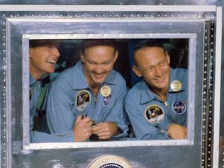 "This July 24, 1969, photo obtained from NASA, shows US President Richard Nixon (R) welcoming the Apollo 11 astronauts aboard the USS Hornet, confined to the Mobile Quarantine Facility  (L to R) Neil Armstrong, commander; Michael Collins, command module pilot; and Edwin Aldrin Jr., lunar module pilot. - When the Saturn V rocket built by Wernher von Braun launched with the Apollo 11 capsule at its summit on July 16 1969, one million people flocked to watch the spectacle on the beaches of Florida near Cape Canaveral. But many had doubts that they'd succeed in landing this time. (Photo by HO / NASA / AFP) / **RESTRICTED TO EDITORIAL USE - MANDATORY CREDIT ""AFP PHOTO / NASA"" - NO MARKETING - NO ADVERTISING CAMPAIGNS - DISTRIBUTED AS A SERVICE TO CLIENTS **TO GO WITH AFP STORY by Ivan Couronne, ""To the Moon and back: mankind's giant leap 50 years on"""