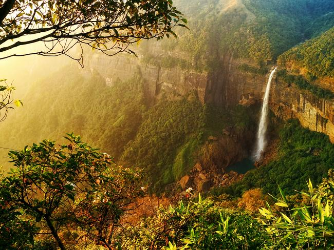 """WATERFALLS AND LIVING ROOT BRIDGES, MEGHALAYA: The northeastern state of Meghalaya is known as the wettest place on Earth, so no surprises its biggest attractions are water-based. Check out dramatic Nohkalikai Waterfalls and the unique living root bridges – extraordinary trees grown strategically so their roots form bridges over the river below. Lonely Planet last year named the state one of Asia's top 10 destinations, advising """"Meghalaya won't stay this quiet for long; go before thrillseekers storm the Khasi Hills"""". Tour operator India Unbound's 17-day North East itinerary takes in waterfalls, living root bridges and visits to local communities.  indiaunbound.com.au"""