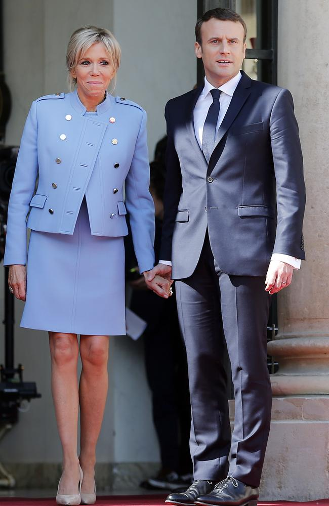 Emmanuel Macron and his wife Brigitte Macron after the handover ceremony with outgoing President Francois Hollande at the Elysee Palace in Paris, France. Picture: Thierry Chesnot/Getty Images