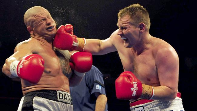 Kyle Brumby puts a big punch on Danyon Greig.