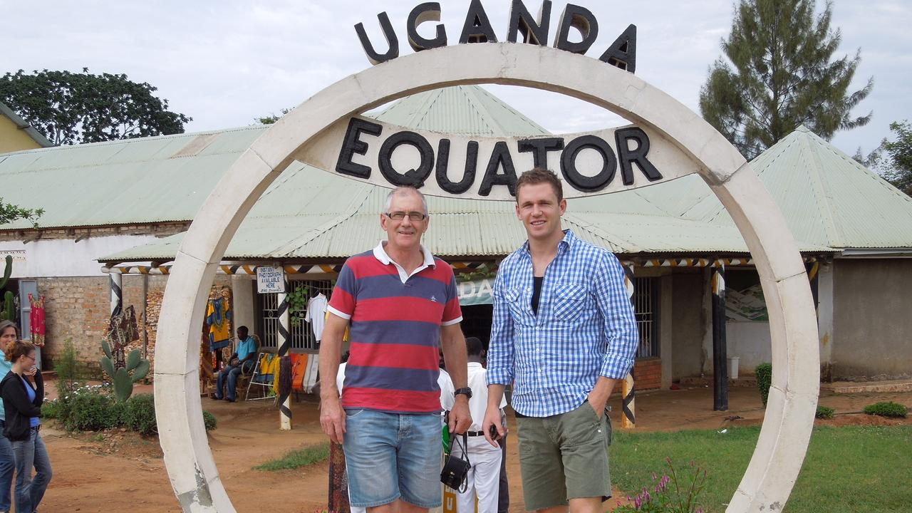 Geelong Cats AFL player Joel Selwood (right) and his dad, Bryce Selwood, at the equator in Uganda on a holiday in recent years. Picture: supplied