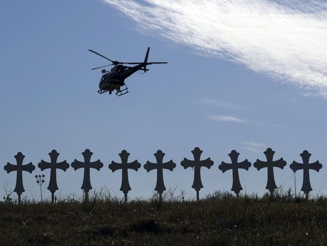 A law enforcement helicopter flies over crosses placed near the scene of a shooting at the First Baptist Church. Picture: AP