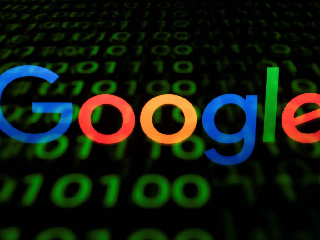 (FILES) This file photo taken in Paris on April 29, 2018 shows the Google logo displayed on a screen and reflected on a tablet. - The EU launched a wide-ranging antitrust probe against Google on June 22, 2021 over concerns that it is forcing out rivals in the highly profitable online advertising market. (Photo by Lionel BONAVENTURE / AFP)