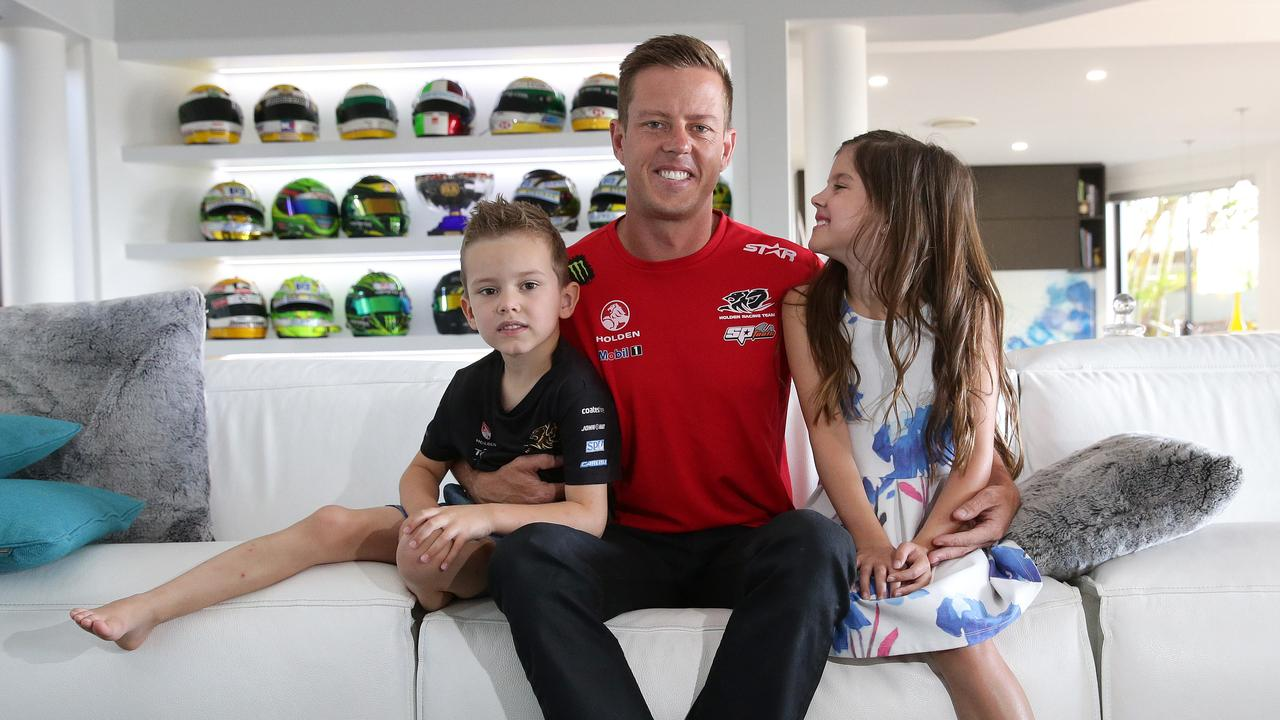 File picture of James Courtney at home during a recovery phase in his career with his children. Picture: Adam Head.
