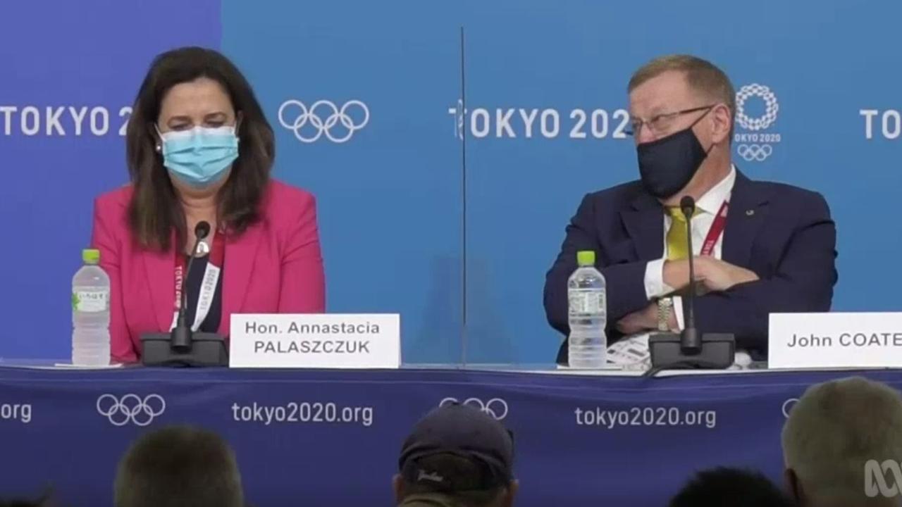 John Coates telling Annastacia Palaszczuk she had to go to the opening ceremony.