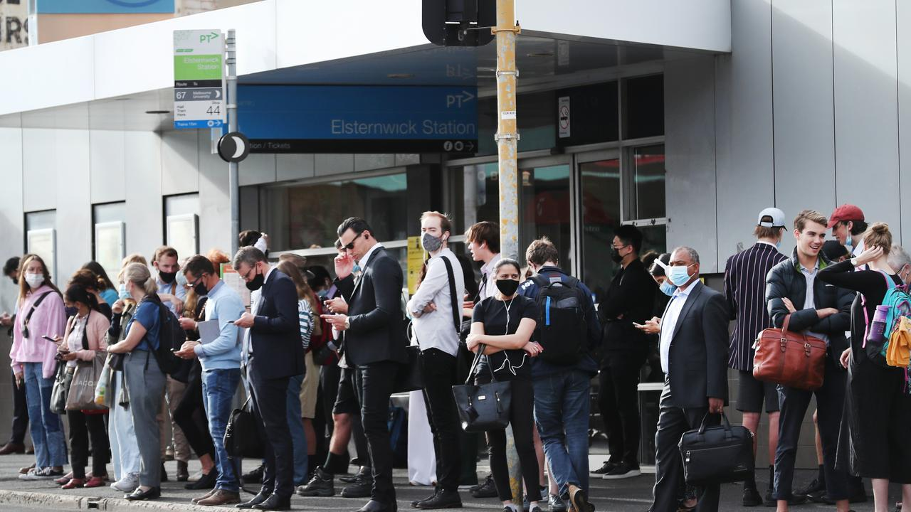 Passengers wait for buses in front of Elsternwick train station after the Sandringham train line was suspended. Picture: NCA NewsWire / David Crosling