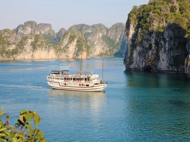12. JOURNEY THROUGH HALONG BAY, VIETNAM Taking a gentle journey among the limestone islands of Halong Bay is a must. Along the way you will see floating fishing villages, have the opportunity to dive into the emerald green waters and view sparsely forested slopes. Helen Wong Tours offers trips which transfer to Halong Bay from Hanoi to join your overnight cruise. It includes a stay in a luxury cabin, and highlights such as morning Tai Chi on the top deck.