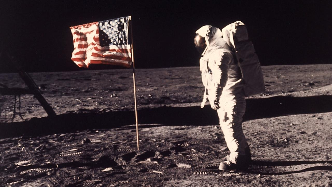 Astronaut Buzz Aldrin beside the US flag on the moon. The appearance of wind on the flag has caused much debate about whether the moon landing was faked. Picture: Neil Armstrong/NASA via AP