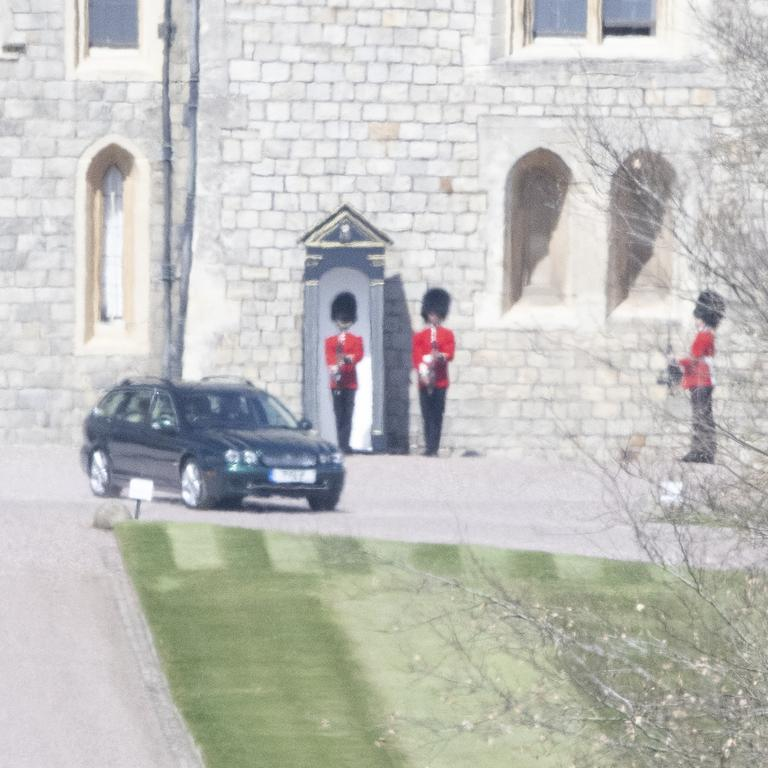 The Queen's car leaves Windsor Castle. Photo credit: News Licensing / MEGA