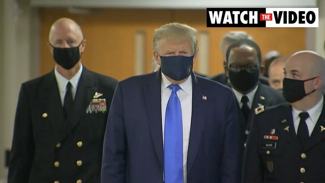 Trump appears in public with a face mask for the first time