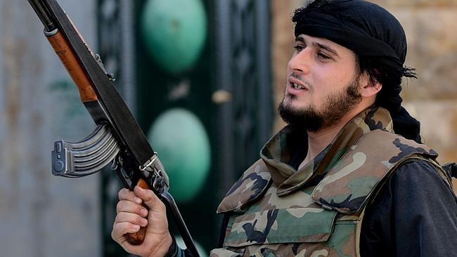 A Syrian rebel fighter holds up his gun in the city of Aleppo 07 Oct 2012. Syrian rebels, lacking heavy arms and air power, ...