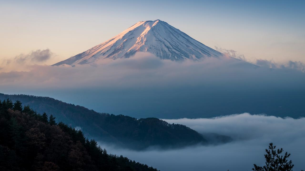 Mount Fuji peaking through the cloud cover.