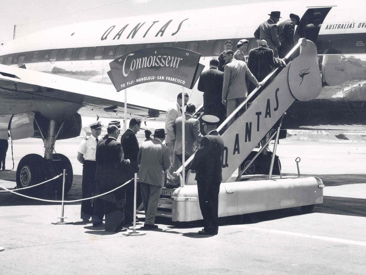 Supplied Editorial Passengers board a Qantas Lockheed Super Constellation in the 1950s. Supplied