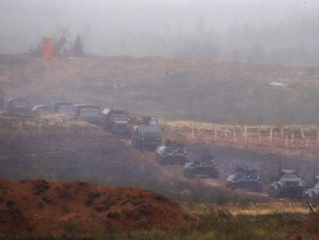 A Russian military column moves through the mud and rain near St. Petersburg, Russia, yesterday. Picture: AP