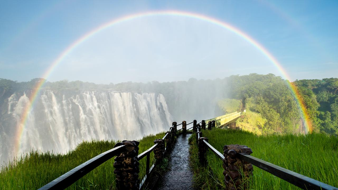 VICTORIA FALLS, ZIMBABWE .. for Chris Pritchard story .. Rainbow ver Victoria Falls walkway Picture: Getty